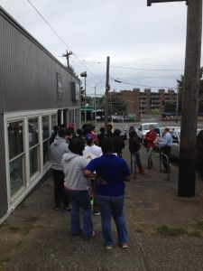 Crowds form outside of the grand opening of Nate's Wings and Waffles.