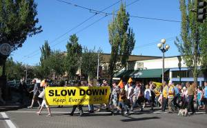 Concerned residents stage a protest in the crosswalk to advocate for slowing traffic along Rainier Avenue. Photo: Rainier Valley Historical Society