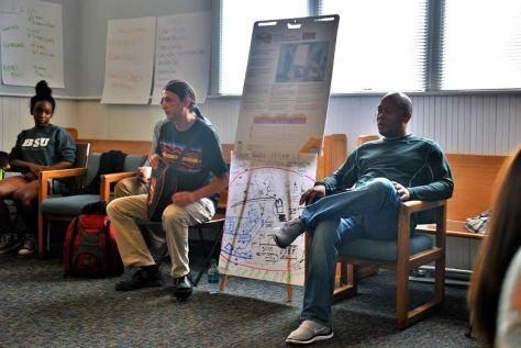 Dustin Washington (right) leads a Freedom School lesson. Photo Credit: Celia Berk