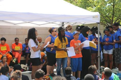 Scholars read advocacy letters to city officials. Photo Credit: TyCeleste