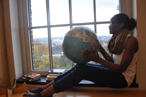Seattle Youth Poet Laureate, Leija Farr, has the whole world in her hands. (Photo by Brie Ripley)