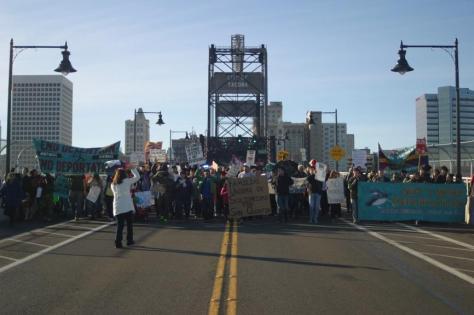 Villalpando leading a NWDCR march at the Port of Tacoma, WA, Nov 21, 2015