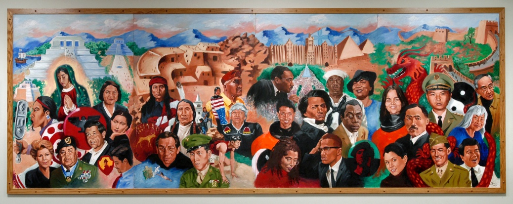 "Painted by artist Jerry Jordan, this mural celebrating ethnic diversity is displayed in the Multicultural Student Center Satellite Office in Gordon Commons residence hall.  Jordan's mural depicts a variety of ethnic groups and the heroes of these communities -- ""people we should all get to know,"" says Jordan.  Jordan is also an advisor and African-American student recruiter for the Office of Admissions.