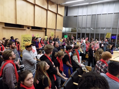 Image 1 Caption--Protestors packed the City Council Chamber.