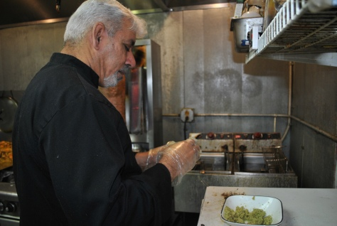 Owner Rami Al-Jabori makes falafel