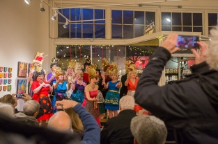 People listen to the Beaconettes sing at the Columbia City Gallery, during the Winter Wonderland Columbia City Beatwalk in Seattle, Washington, on Dec. 14, 2019. (Photo: Carolyn Bick)